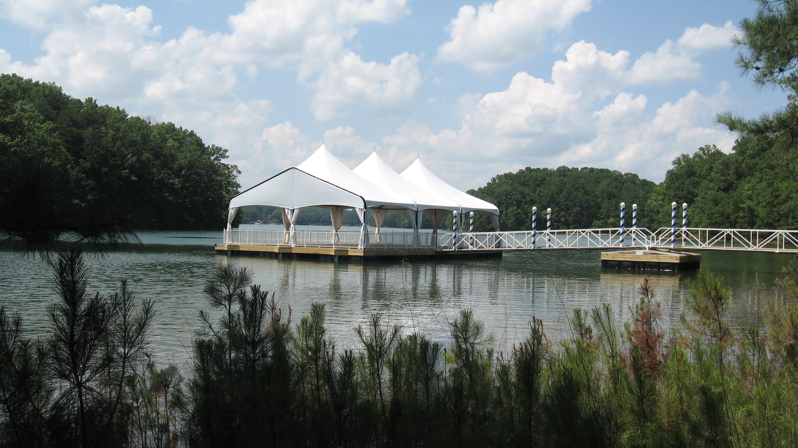 Tent with peaks on a floating lake pavilion