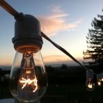 Hanging white cafe string lights outside