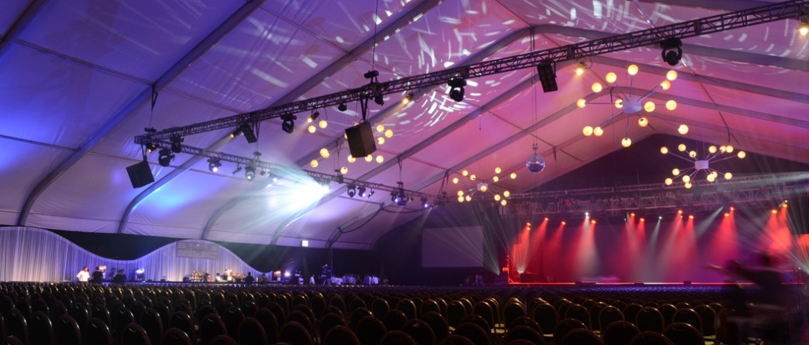 Fastrack 160 extra large event tent inside set up with lights and chairs for political event